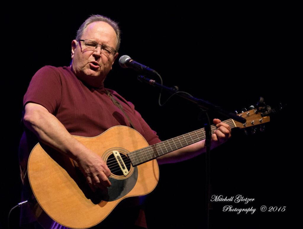 Steve Seskin playing guitar