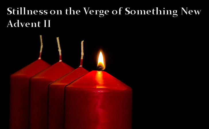 Four red candles against a black background.