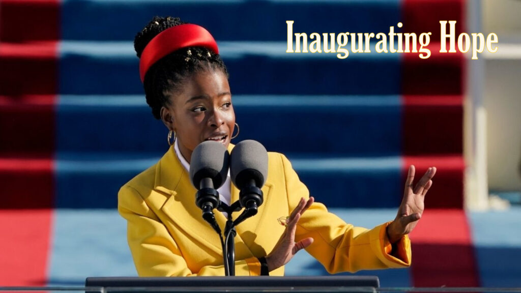 Photo of Amanda Gorman, reciting her poem at the 2021 inauguration of President Joseph R. Biden. She is standing in front of a microphone, looking out to the crowd.