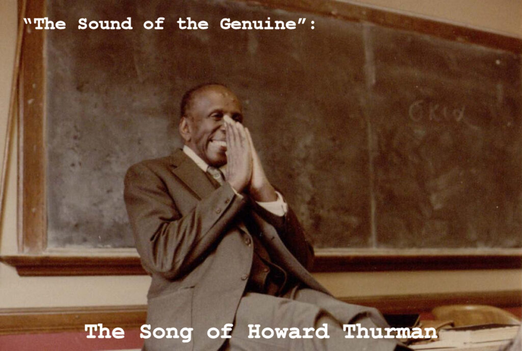 Sepia colored two-tone photograph of Howard Thurman sitting on a school desk with his back against a blackboard. His hands are clasped in a prayer-like fashion against his mouth and nose.