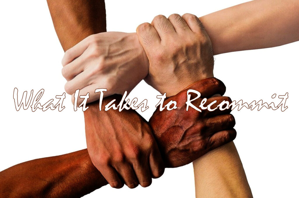 "Four people of varied skin tones (from very light to very dark), holding each other by the wrist so as to form a square. Across the image are the words, ""What It Takes To Recommit."""